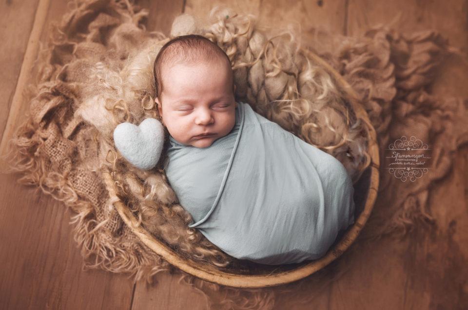 Pucken- Sicher und geborgen beim Newbornshooting